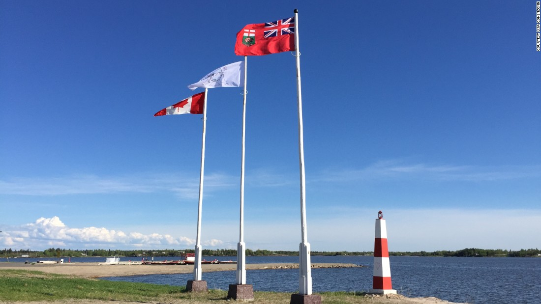 From left to right, the flags of Canada, Norway House Cree Nation, and the province of Manitoba.