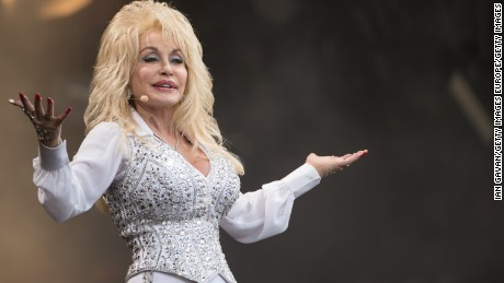 GLASTONBURY, ENGLAND - JUNE 29: Dolly Parton performs on the Pyramid Stage during Day 3 of the Glastonbury Festival at Worthy Farm on June 29, 2014 in Glastonbury, England.  (Photo by Ian Gavan/Getty Images)