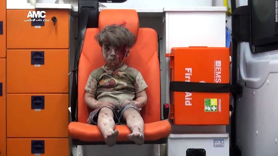 "This still image, taken from a <a href=""https://www.youtube.com/watch?v=7cfBmRW3isc"" target=""_blank"">video posted by the Aleppo Media Center,</a> shows a young boy in an ambulance after an airstrike in the northern Syrian city of Aleppo on Wednesday, August 17. The boy has been identified as Omran Daqneesh, and the video of him has been circulating on social media."
