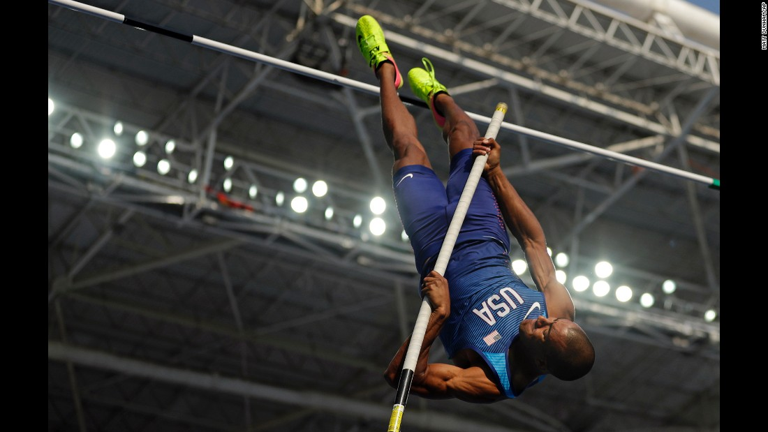"U.S. decathlete Ashton Eaton competes in the pole vault. He went on to win the decathlon, <a href=""http://www.cnn.com/2016/08/18/sport/ashton-eaton-decathlon-rio/index.html"" target=""_blank"">defending his Olympic title</a> from 2012."