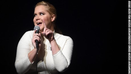 Comedian Amy Schumer and her beau fell ill in Paris.