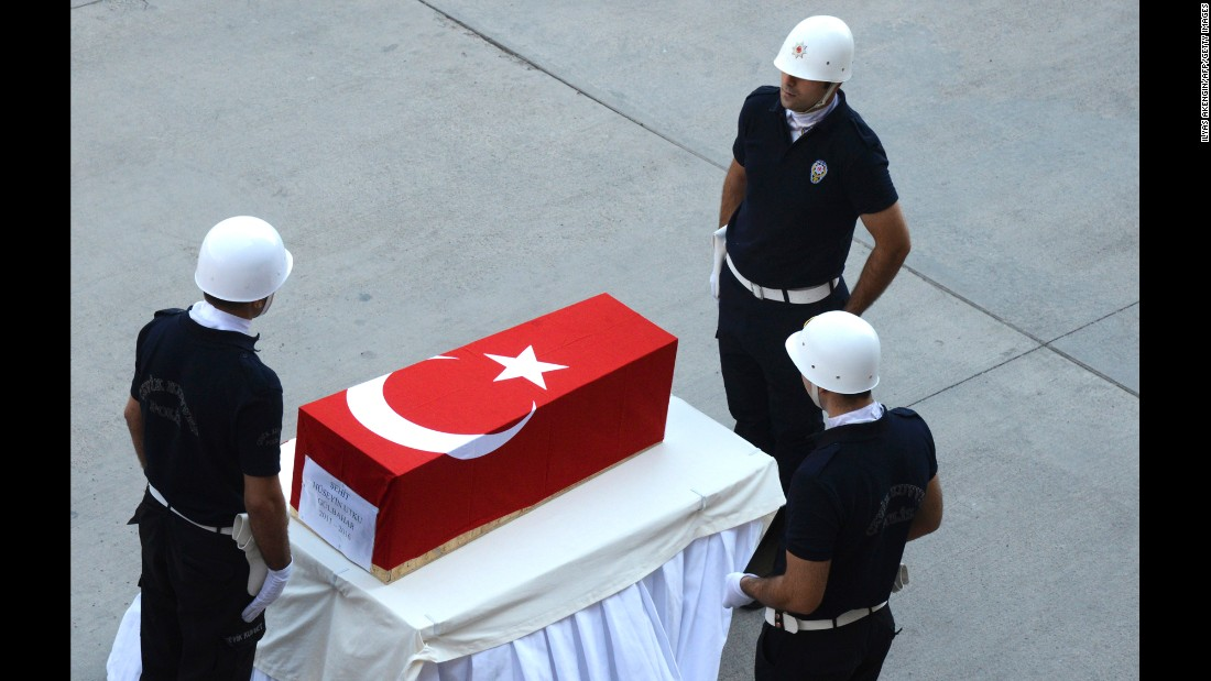 Soldiers stand around the coffin of a 5-year-old bombing victim during a funeral in Diyarbakir, Turkey, on Tuesday, August 16. Five Turkish police officers and two civilians were killed in a car bombing that the government blamed on Kurdish militants.