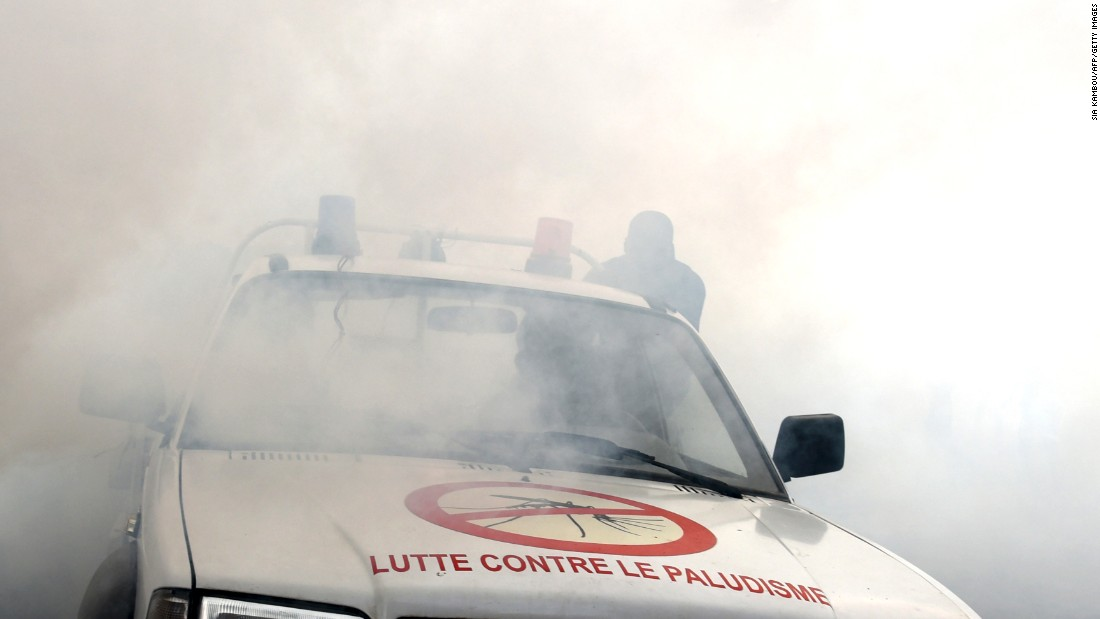 To prevent the spread of the Zika virus, a team from the National Institute of Public Health sprays anti-mosquito product through the Koumassi district of Abidjan, Ivory Coast,  on Monday, August 15.