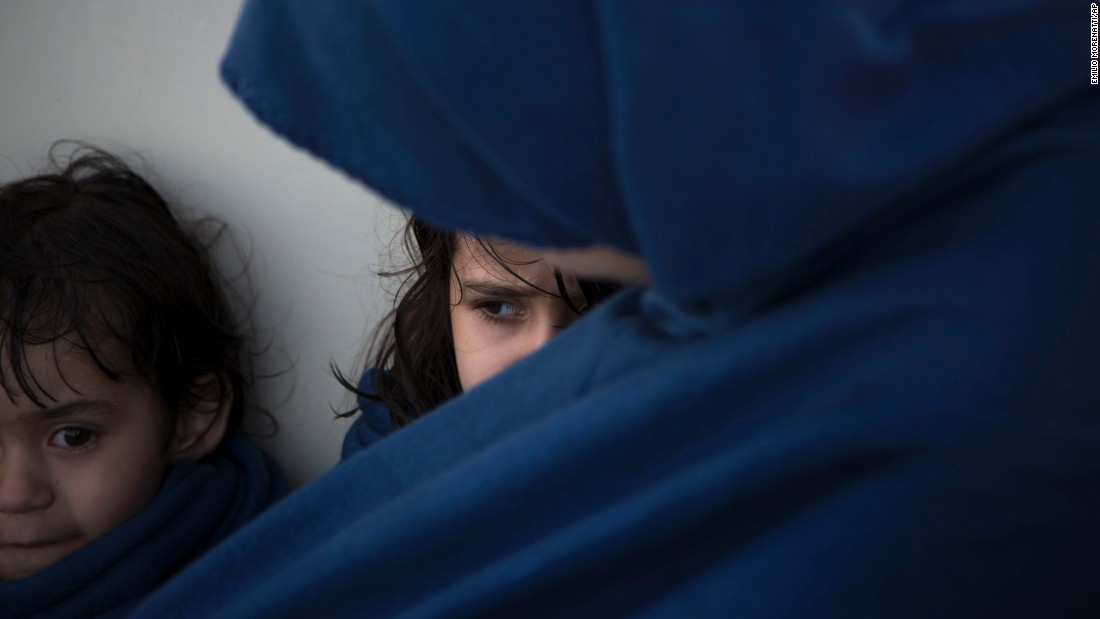 "Osida, 5, sits next to her mother, Aycha, after they were rescued from a sinking boat in the Mediterranean Sea north of Sabratha, Libya, on Thursday, August 18. <a href=""http://www.cnn.com/2015/09/03/world/gallery/europes-refugee-crisis/index.html"" target=""_blank"">Photos: Europe's migration crisis</a>"