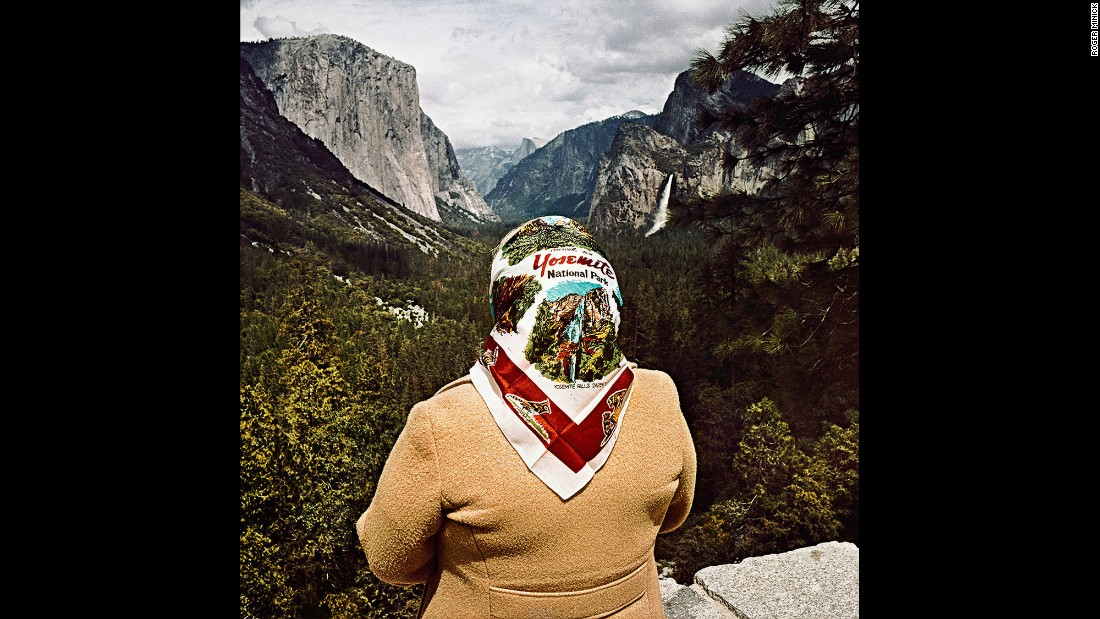 <em>Woman with Scarf at Inspiration Point, Yosemite National Park, California, 1980.</em> Minick got interested in the phenomenon of sightseeing while observing tourists at scenic overlooks in the American West.
