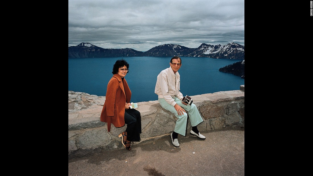 <em>Couple Taking Polaroids at Crater lake National Park, Oregon, 1980. </em>Minick often offered to take Polaroids of his subjects before he photographed them with his other camera. This couple had a Polaroid camera, too.