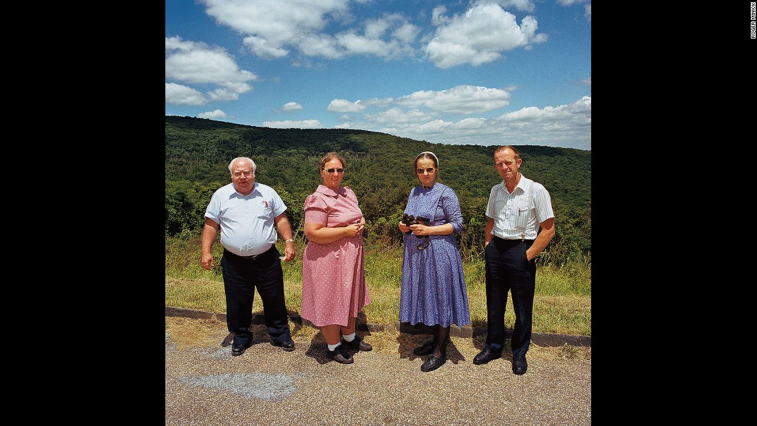 <em>Two Hutterite couples at Shenandoah National Park, Virginia, 1999. </em>Color drives the series, which Minick realized after first photographing sightseers in black and white.