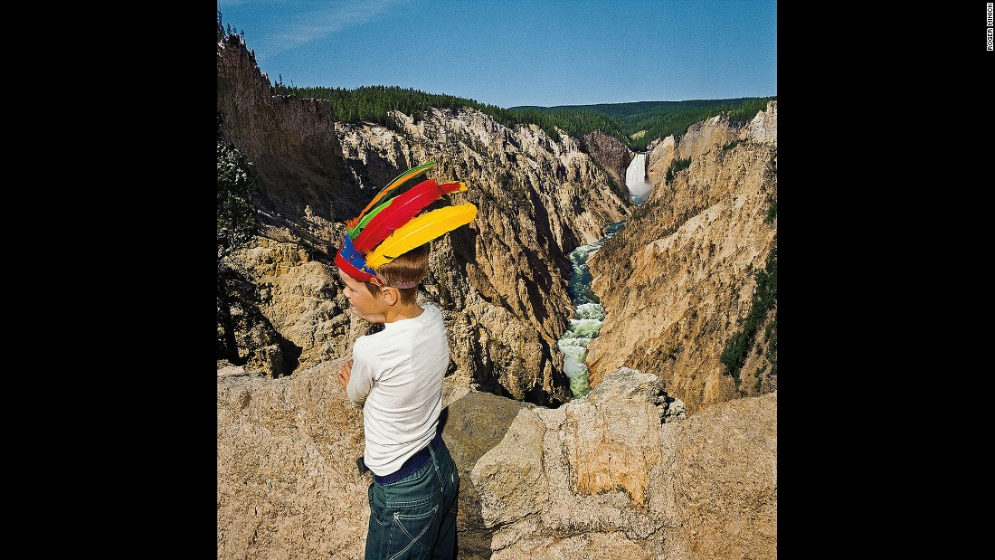 <em>Boy with Feathered Headress at Lower Falls Overlook, Yellowstone National Park, 1980. </em>Minick spent time at hundreds of overlooks, scouting for visually arresting combinations of people and scenery.