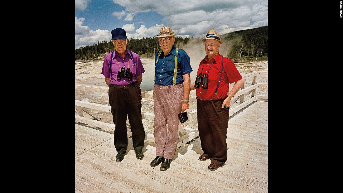 "<em>Three Men in Color Coordinated Shirts at Upper Geyser Basin, Yellowstone National Park, Wyoming, 1980.</em> Minick spotted these men from a distance. ""I saw those three spots of color and I said, 'Oh my God, that's too good.'"""