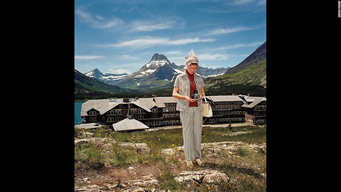 "<em>Woman Taking Photograph at Many Glacier Hotel, Glacier National Park, Montana, 1981. </em>Some of the subjects' wardrobe choices were questionable. Not this ""very classy lady."""