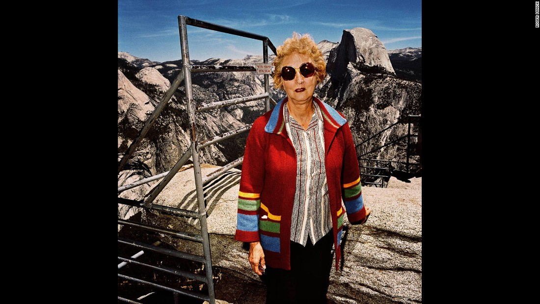 <em>Woman with Red Sweater at Glacier Point, Yosemite National Park, California, 1981. </em>Minick usually approached his subjects at overlooks and asked to take their pictures. He didn't get their names, but he often wonders about the tourists he photographed.
