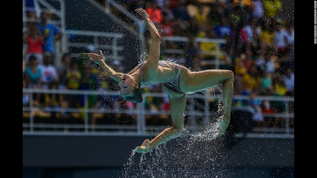 Synchronized swimmers from Russia perform their technical routine.