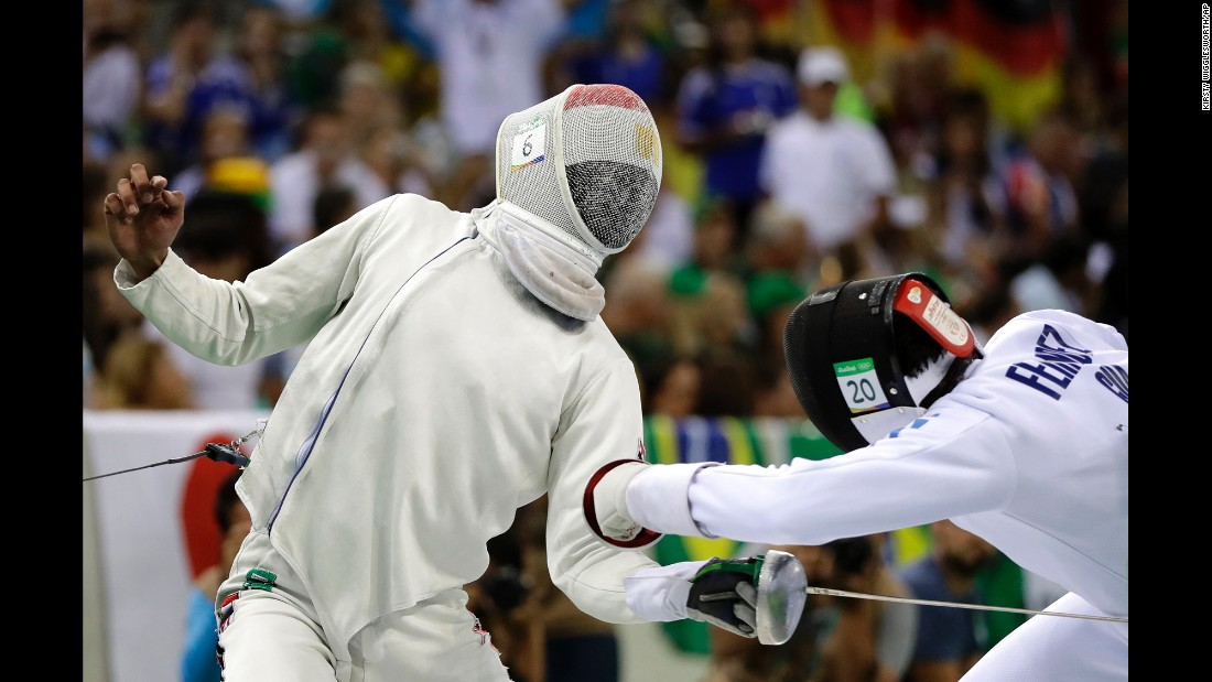 Egypt's Omar El Geziry, left, competes against Guatemala's Charles Fernandez during the fencing portion of the modern pentathlon.