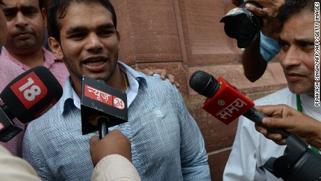 Yadav speaks to media leaving Parliament House in New Delhi on August 2, 2016. India's anti-doping agency revived his hopes of Olympics glory by clearing him of consuming a banned substance.