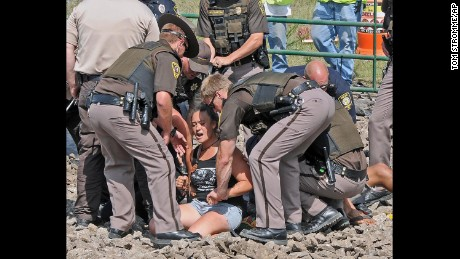 Law enforcement confronts protesters on a road to be used to build the Dakota Access Pipeline.