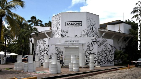 "View of the facade of restaurant ""La Leche"" (The milk) on August 17, 2016 in Puerto Vallarta, in the western Mexican state of Jalisco, where Jesus Alfredo Guzman Salazar, son of drug lord Joaquin ""El Chapo"" Guzman, was kidnapped among other five clients Monday, authorities confirmed Tuesday.  Seven gunmen in pickup trucks swooped on the upscale bar and restaurant Monday around dawn and abducted the victims. Investigators said it was likely part of a settling of scores between rival drug cartels. / AFP / HECTOR GUERRERO        (Photo credit should read HECTOR GUERRERO/AFP/Getty Images)"