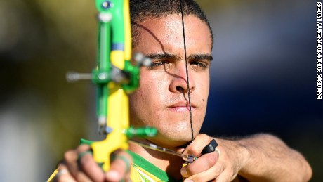 Brazilian military athlete Bernardo Oliveira trains recurve archery for the Rio 2016 Olympic Games, at the Army Club in Brasilia on July 8, 2016. Brazil has 142 Olympic athletes connected to the military forming a huge contingent within the 465-strong Brazilian team. The country has a military program to train its members in sports that dates back to 2008 when it organized the World Military Games, winning them three years later. / AFP / EVARISTO SA        (Photo credit should read EVARISTO SA/AFP/Getty Images)