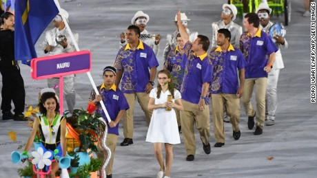 Nauru's flagbearer Elson Brechtefeld leads his delegation during the opening ceremony of the Rio 2016 Olympic Games at the Maracana stadium in Rio de Janeiro on August 5, 2016. / AFP / PEDRO UGARTE        (Photo credit should read PEDRO UGARTE/AFP/Getty Images)