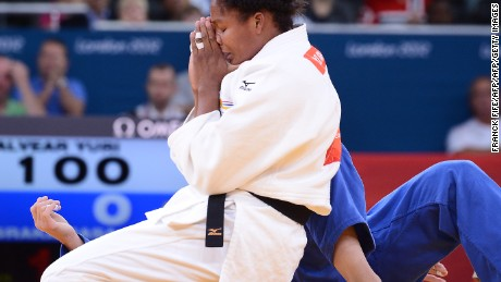Colombia's Yuri Alvear (white) reacts as she won against Slovenia's Rasa Sraka (blue) during their women's -70kg judo contest repechage match of the London 2012 Olympic Games on August 1, 2012 at the ExCel arena in London. AFP PHOTO / FRANCK FIFE        (Photo credit should read FRANCK FIFE/AFP/GettyImages)