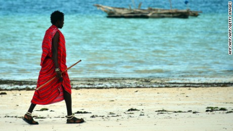A local man walks on a beach on January 8, 2013 in Zanzibar.  AFP PHOTO / GABRIEL BOUYS        (Photo credit should read GABRIEL BOUYS/AFP/Getty Images)