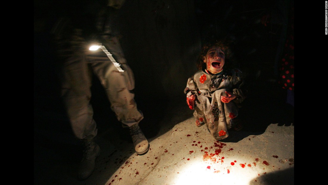 """<strong>2005: Tal Afar, Iraq</strong> -- In a time when truly resonant war photos were hard to come by due to the dangerous climate in Iraq, a photographer <a href=""""http://time.com/3808940/remembering-chris-hondros/"""" target=""""_blank"""">captured a truly wrenching moment.</a> The girl is Samar Hassan, screaming and spattered with blood after her parents were mistakenly killed and her brother was wounded by U.S. troops. The image was widely used to represent the true civilian cost of international conflict."""