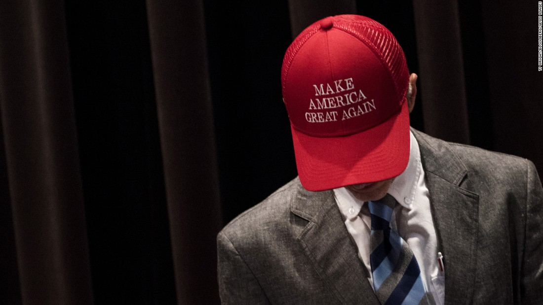 An man wears a hat with Donald Trump's campaign slogan before the Republican nominee attended an event in Youngstown, Ohio, on Monday, August 15.