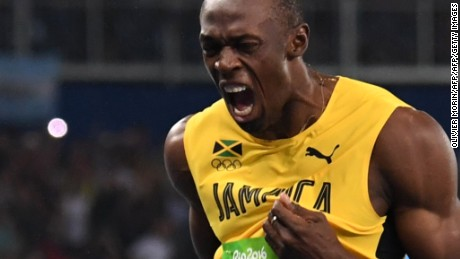 Jamaica's Usain Bolt (L) reacts after he crossed the finish line to win the Men's 200m Final during the athletics event at the Rio 2016 Olympic Games at the Olympic Stadium in Rio de Janeiro on August 18, 2016.   / AFP / OLIVIER MORIN        (Photo credit should read OLIVIER MORIN/AFP/Getty Images)