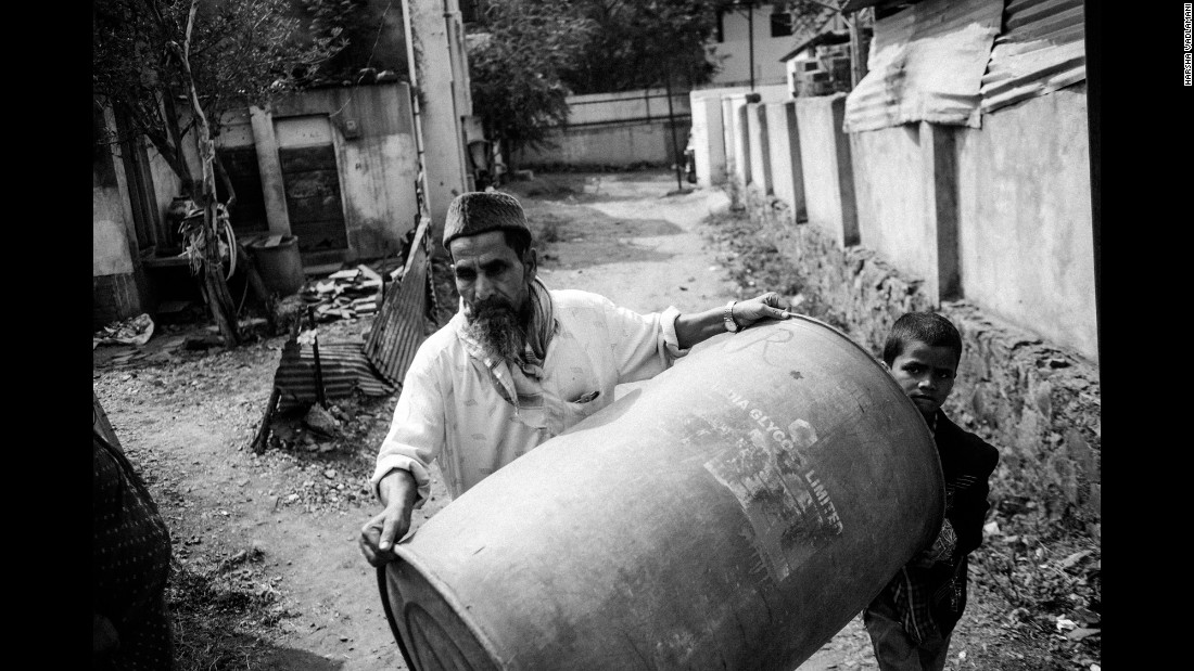 A man rushes with a water drum as a water tanker arrives in Latur, India.