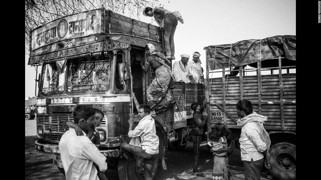 Every year, thousands of farmers and landless farm workers from the Marathwada region migrate to western Maharashtra and neighboring Karnataka to harvest sugarcane for the mills there, usually for a period of six months. Here, migrants returning from Karnataka transfer to smaller vehicles in Dharur before traveling back to their respective villages.
