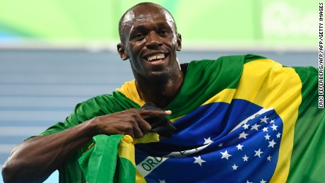 Jamaica's Usain Bolt celebrates his team's victory at the end of the Men's 4x100m Relay Final during the athletics event at the Rio 2016 Olympic Games at the Olympic Stadium in Rio de Janeiro on August 19, 2016.   / AFP / Eric FEFERBERG        (Photo credit should read ERIC FEFERBERG/AFP/Getty Images)