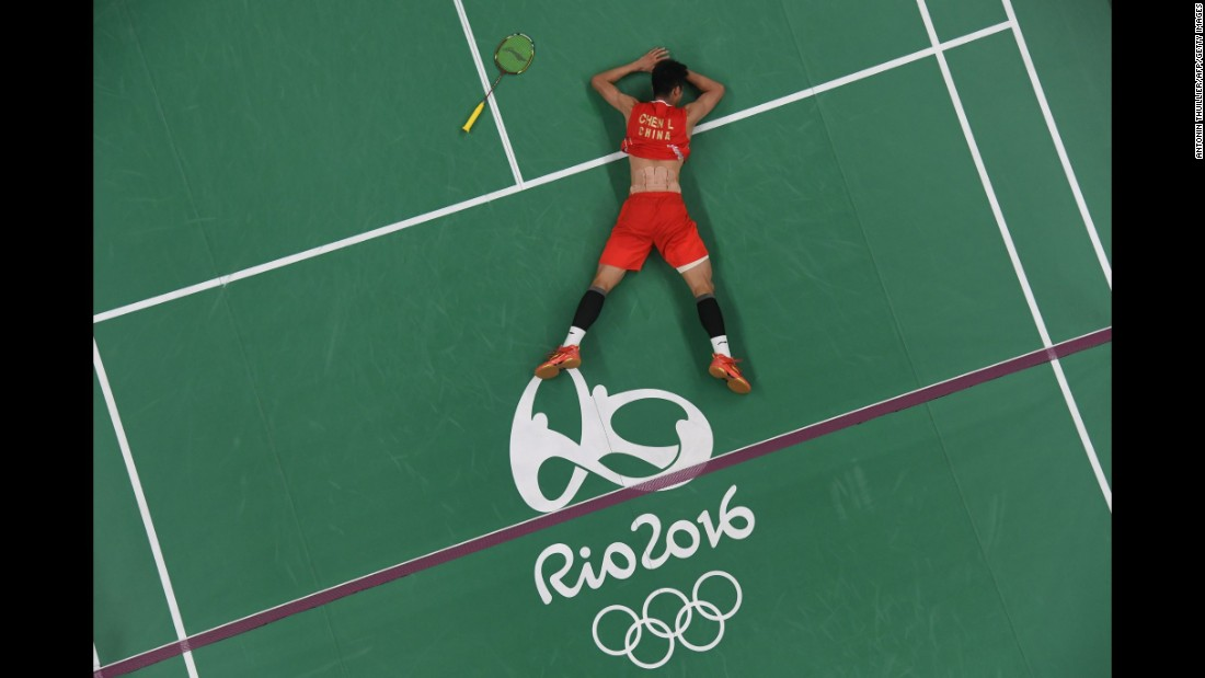 China's Chen Long reacts after winning gold against Malaysia's Lee Chong Wei in their badminton singles match.