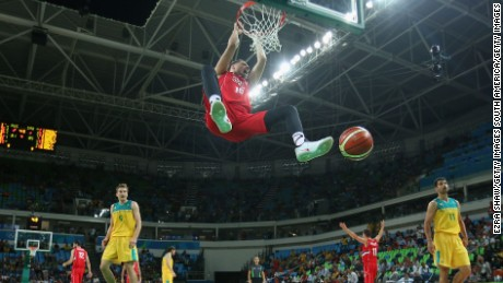 Serbia's Vladimir Stimac slam dunks the ball during the semifinal  against Australia.