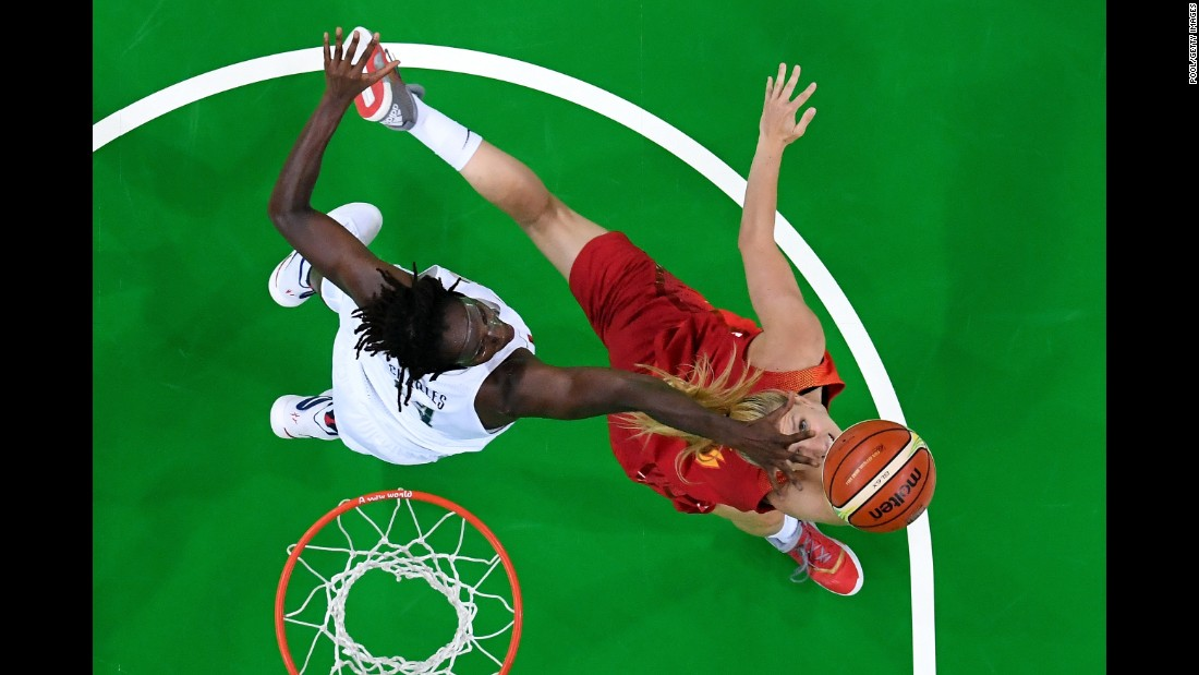 "U.S. basketball player Tina Charles, left, and Spain's Laura Gil battle for the ball in the final game on Saturday, August 20. The Americans earned yet another gold, making it their <a href=""http://www.cnn.com/2016/08/20/sport/rio-olympics-womens-basketball-usa-spain-final/"" target=""_blank"">sixth straight Olympic win</a>."