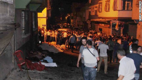 People gather at the scene of an explosion in Gaziantep.
