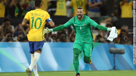 Brazil goalkeeper Weverton celebrates with Neymar at the Maracana Stadium.