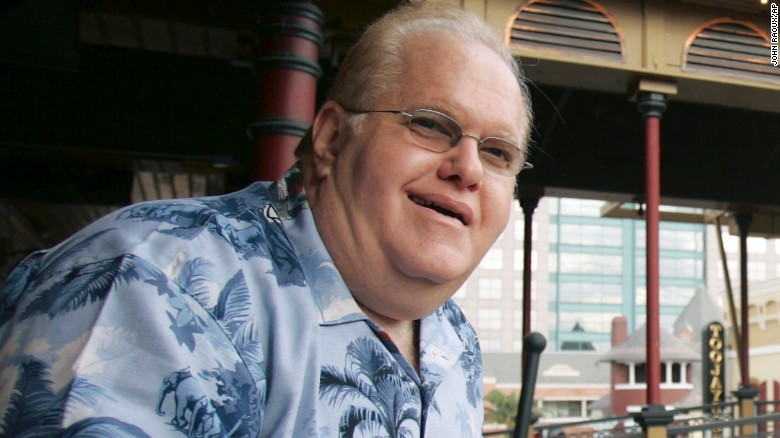 FILE- In this June 27, 2007, file photo Lou Pearlman poses outside his office's at Church Street Station in Orlando, Fla. Pearlman, credited for starting the boy-band craze and launching the careers of the Backstreet Boys and 'NSync, has died in prison while serving a 25-year sentence for a massive Ponzi scheme. The Orlando Sentinel reported that according to a federal inmate database, the 62-year-old Pearlman died Friday, Aug. 19, 2016. (AP Photo/John Raoux, File)