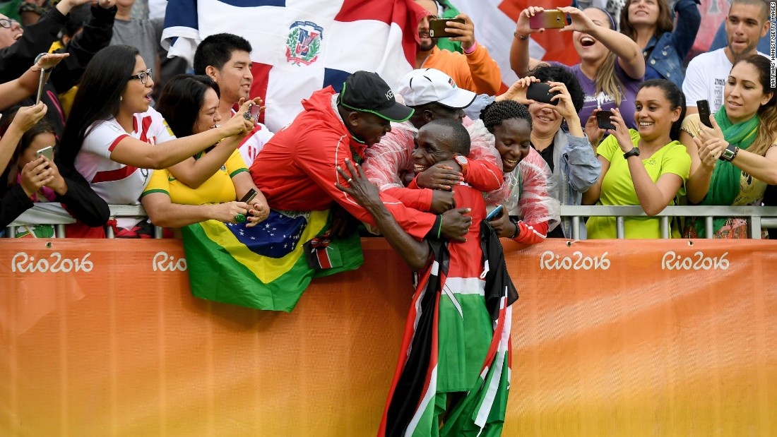 Eliud Kipchoge of Kenya celebrates after earning gold in the marathon.