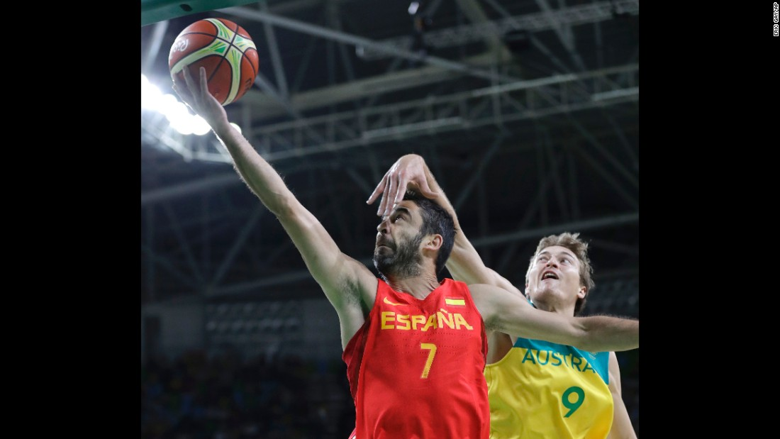 Spain's Juan Carlos Navarro, left, goes for the basket against Ryan Broekhoff of Australia during their bronze medal basketball game. The Spaniards won 89-88.
