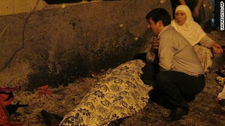 A man mourns a victim of the terror attack at a wedding in Gaziantep, southeastern Turkey.