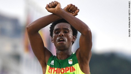 Ethiopia's Feyisa Lilesa crossed his arms above his head at the finish line.