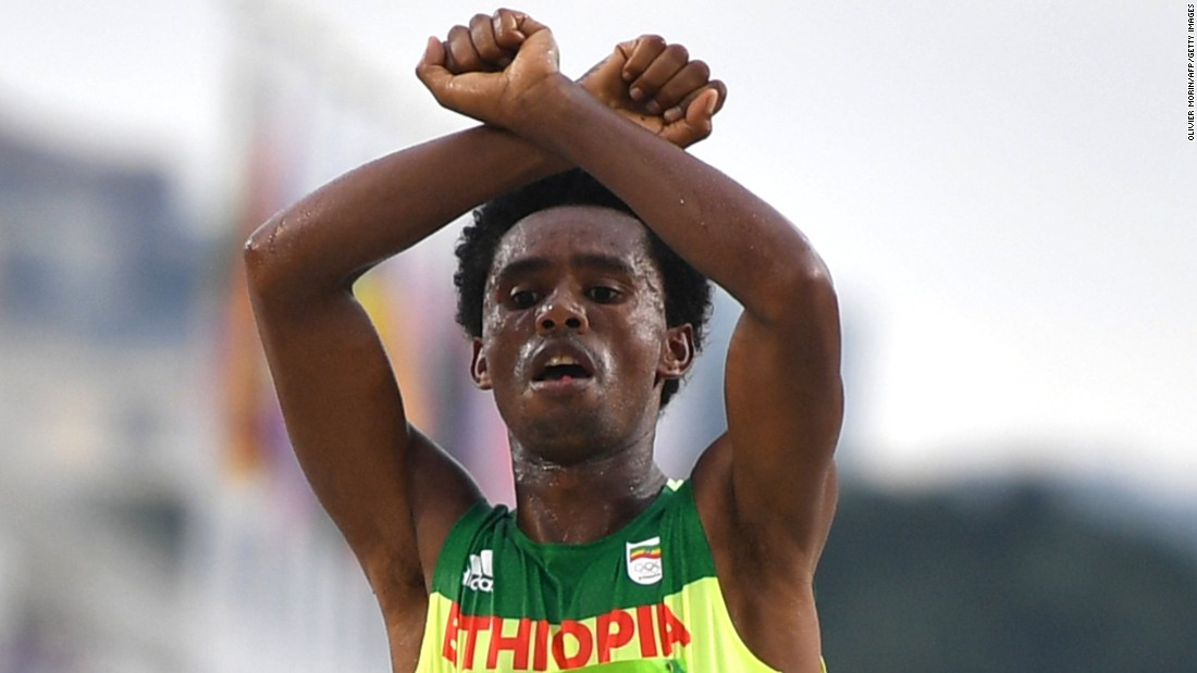 "Ethiopia's Feyisa Lilesa crosses his wrists above his head as he finishes the marathon. Lilesa earned silver in the race and <a href=""http://www.latimes.com/sports/olympics/la-sp-oly-rio-2016-silver-medalist-feyisa-lilesa-shows-1471800285-htmlstory.html"" target=""_blank"">said his gesture</a> was in solidarity with <a href=""http://www.cnn.com/2016/08/09/africa/ethiopia-oromo-protest/index.html"" target=""_blank"">the protesters in his home country</a>, who have been staging a resistance movement against the Ethiopian government."