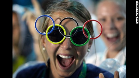 Jackie Briggs from the United States wears Olympic ring sunglasses.