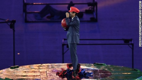 Japanese Prime Minister Shinzo Abe, dressed as Super Mario, holds a red ball during the closing ceremony of the Rio 2016 Olympic Games in Rio de Janeiro.