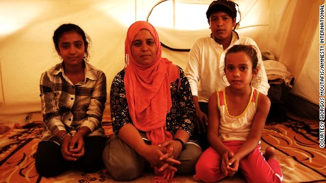 Zalasht's (center) husband was killed by a car bomb in Afghanistan. She is now stranded in Greece with her children.