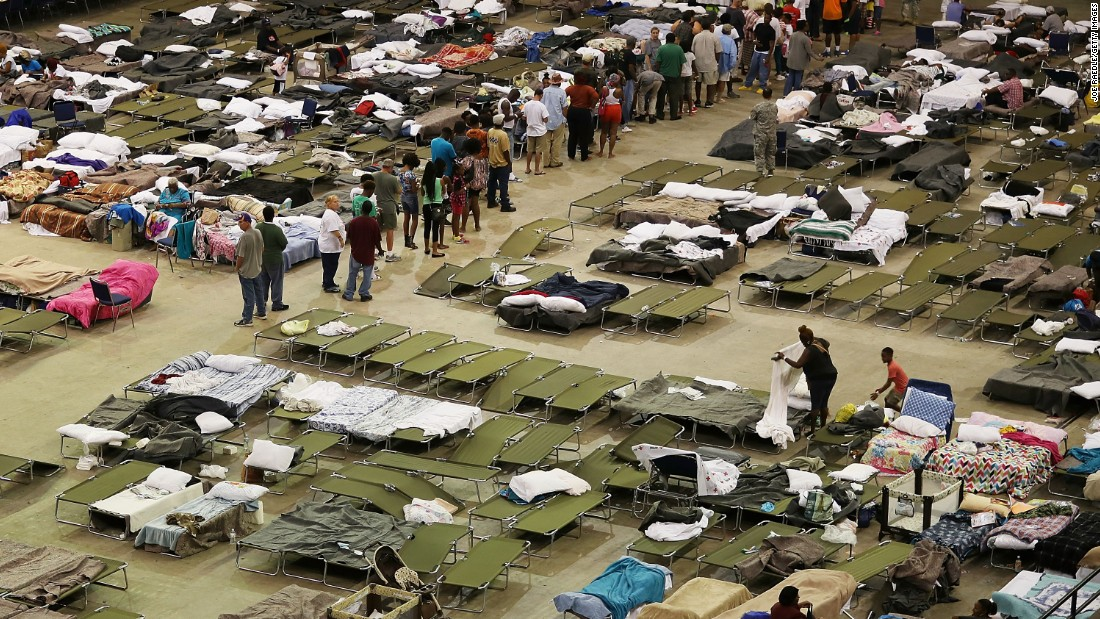 Evacuees take advantage of the shelter setup in the The Baton Rouge River Center arena.