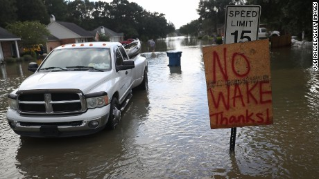 A no wake sign is seen along side a street in a residential neighborhood inundated with flood waters on August 17, 2016 in Sorrento, Louisiana. Tremendous downpours have resulted in disastrous flooding, responsible for at least seven deaths and thousands of homes being damaged.