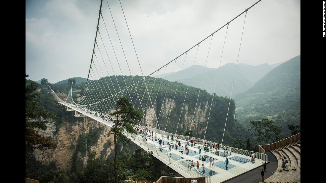 "Israeli architectural firm Haim Dotan has never been one to shy away from a challenge, and the Zhangjiajie Grand Canyon Glass Bridge is in a league of its own. Inspired by the movie ""Avatar"" and its fictional world, the suspended bridge is composed of glass panels and can hold up to 800 visitors at a time. The bridge opened for a short stint in August 2016, but closed when it was <a href=""http://edition.cnn.com/2016/09/02/travel/china-zhangjiajie-glass-bridge-closed/"" target=""_blank"">""overwhelmed by the number of visitors.""</a> When it reopens in 2017, the structure will be the longest glass pedestrian bridge in the world, stretching 1,250 feet and hovering nearly 1,000 feet above Zhangjiajie Grand Canyon, a UNESCO World Heritage Site."