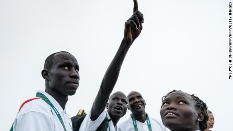 South Sudan's athletes James Nyang Chiengjiek (L), Yiech Pur Biel (2nd L) and Rose Nathike Lokonyen.