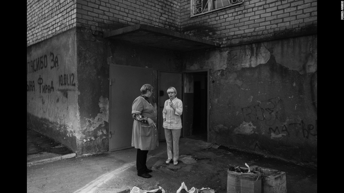 Two nurses take a break outside of a maternity ward in Kramatorsk, Ukraine. According to photographer Pascal Vossen and writer Nils Adler, the ward had no functioning toilets -- a sign of its poor condition.