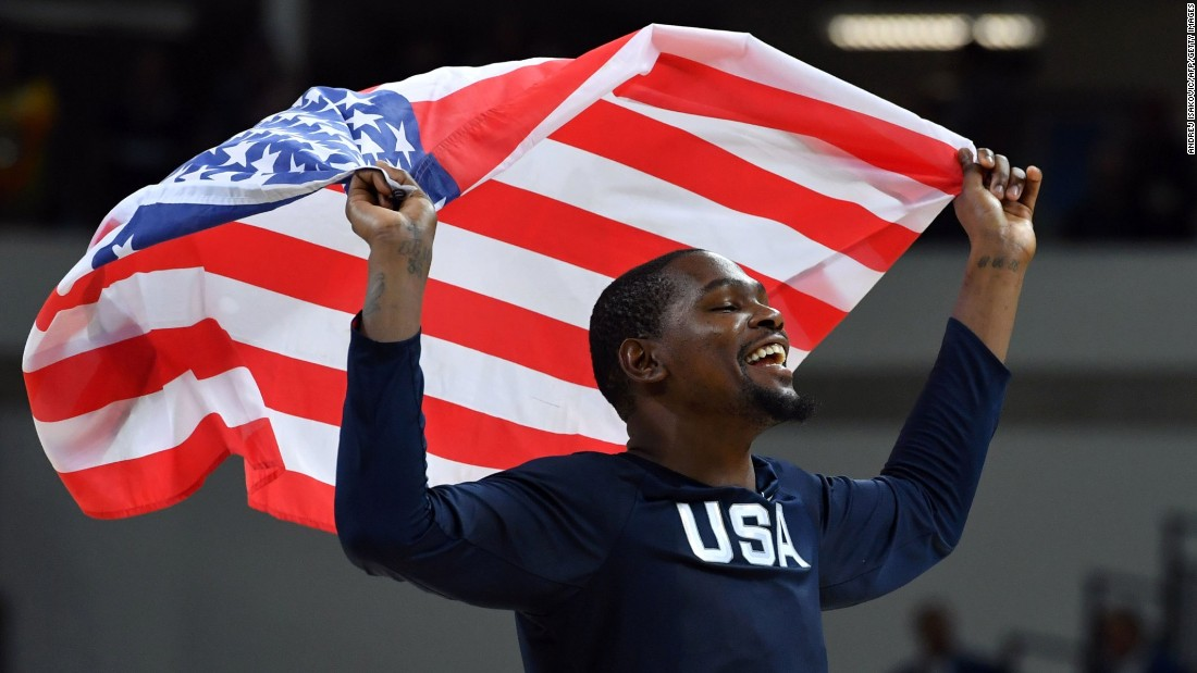 U.S. basketball star Kevin Durant celebrates with the American flag after the gold-medal win against Serbia on Sunday, August 21.